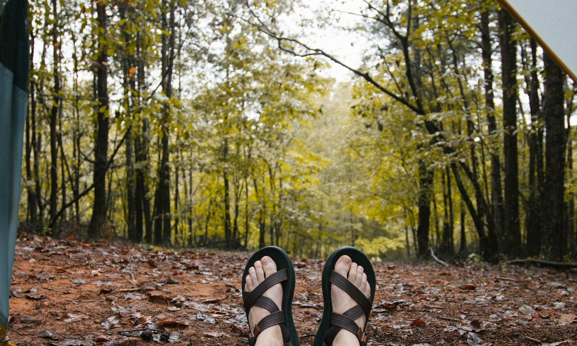 WEARING CHACO SANDALS IN A TENT IN THE WOODS